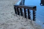 Поиск золота на пляже путем траления
